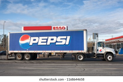 ELMSDALE, CANADA - DECEMBER 06, 2016: Pepsi truck parked at Esso gas station. Pepsi is a worldwide popular soft drink produced by PepsiCo.