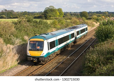 ELMSWELL, SUFFOLK, UK - OCTOBER 13, 2012: Still showing signs of its Anglia Railways heritage, Greater Anglia Class 170 No. 170272 heads east through the Suffolk countryside with a service to Ipswich.