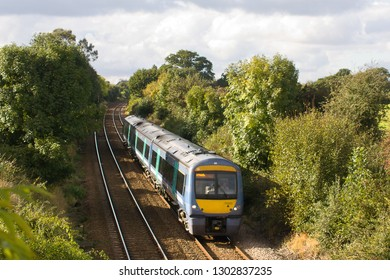 ELMSWELL, SUFFOLK, UK - OCTOBER 13, 2012: Greater Anglia Class 170 No. 170203 heads east away from Elmswell, amidst the rural Suffolk countryside, working the 13:45 Peterborough to Ipswich service.