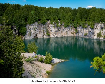 Elora Quarry, Ontario, Canada with people sitting on beach