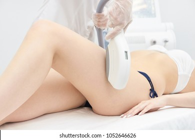 Elos Laser Legs Hair Removal. Epilation Treatment In Cosmetic Beauty Clinic.