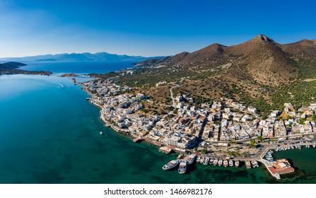 ELOUNDA, CRETE, GREECE - 13 JULY 2019: Aerial view of the up market town of Elounda on the greek island of Crete