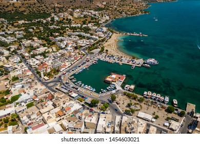 ELOUNDA, CRETE, GREECE - JULY 16 2019: Aerial view of the popular high-end tourist town of Elounda on the Greek island of Crete in the Aegean Sea.