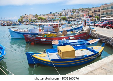 ELOUNDA, CRETE - JUNE 29: Traditional boats in the harbor of Elounda on June 29th, 2015, Crete, Greece.