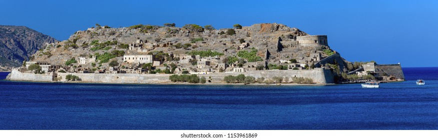 Elounda,Crete, Greece - July 11 2018: The island of Spinalonga, officially known as Kalydon is located in the Gulf of Elounda in north-eastern Crete, in Lasithi, next to the town of Plaka.