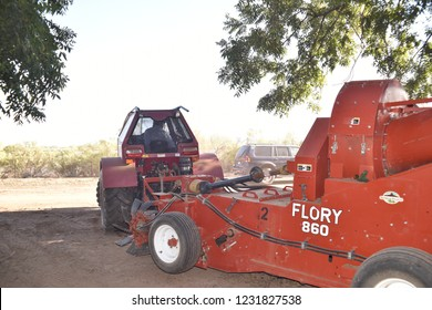 Eloy, AZ., U.S.A. Oct. 26, 2018. Daybreak Pecan Co. John Deere and Farmall tractors with Flory 850 and 860 nut harvesters and a jackrabbit bin