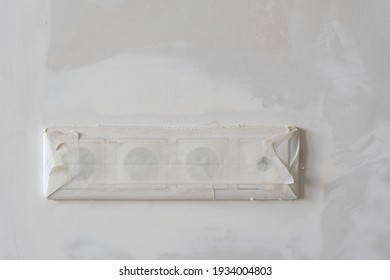 Elrctric socket sealed with white adhesive tape to avoid risk of getting dust into it during reparing process. Protection against electric shock.