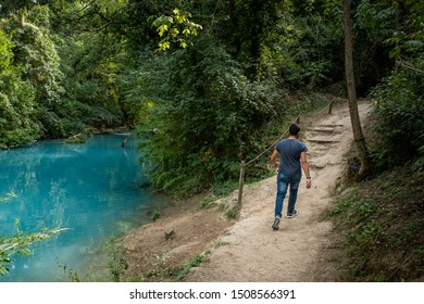 ELSA RIVER, ITALY - SEPTEMBER 15, 2019: one unknown man at Elsa river park, the trail starts in Gracciano and reaches in Colle Val d'Elsa (Siena, Tuscany) the river's waters are turquoise color
