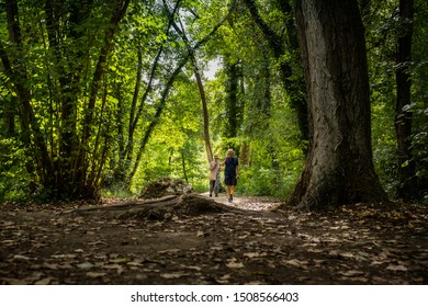 ELSA RIVER, ITALY - SEPTEMBER 15, 2019: two people unknown at Elsa river park, the trail starts in Gracciano and reaches in Colle Val d'Elsa (Siena, Tuscany) the river's waters are turquoise