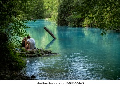ELSA RIVER, ITALY - SEPTEMBER 15, 2019: two people unknown at Elsa river park, the trail starts in Gracciano and reaches in Colle Val d'Elsa (Siena, Tuscany) the river's waters are  turquoise color