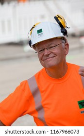 Elsfleth, Germany - August 29, 2018: Portrait of Stephan Weil, Prime Minister of Lower Saxony with white helmet and orange safety shirt of a street worker