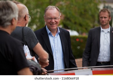 Elsfleth, Germany - August 29, 2018: Stephan Weil, Prime Minister of Lower Saxony shakes hands with people and smiles
