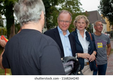 Elsfleth, Germany - August 29, 2018: Stephan Weil, Prime Minister of Lower Saxony and Karin Logemann, member of parliament, speak to people