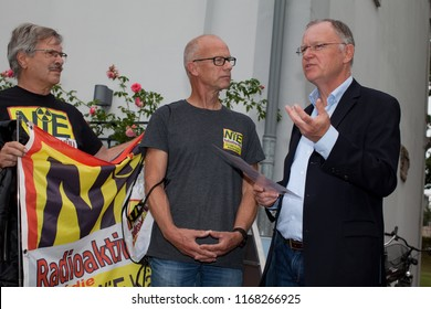 Elsfleth, Germany - August 29, 2018: Stephan Weil, Prime Minister of Lower Saxony in discussion with activists against nuclear garbage on the local disposal site in Kaeseburg