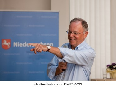 Elsfleth, Germany - August 29, 2018: Stephan Weil, Prime Minister of Lower Saxony in front of a blue banner speaks  to the public and points to the audience to explain his position
