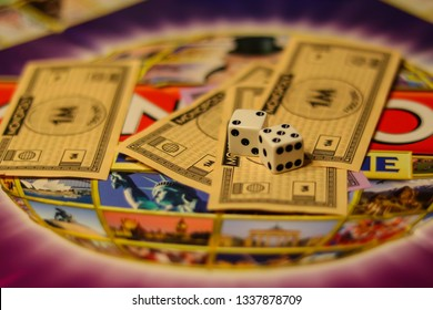 Elspeet, Netherlands - March 2019: Dice and money on monopoly board game