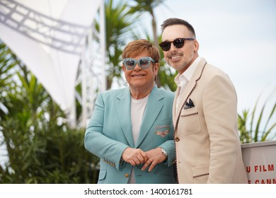 "Elton John and David Furnish attend the photocall for ""Rocketman"" during the 72nd annual Cannes Film Festival on May 16, 2019 in Cannes, France."