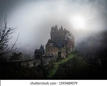 Eltz, Germany. 24 November 2019. Medieval Eltz Castle in a mystic, cloudy setting on a foggy autumn day.