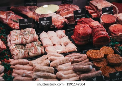 Elveden, UK - April 21, 2019: Variety of meats and meat products on sale inside The Courtyard, a country mall that sells gifts and locally produced food, and located just off A11 in Elveden, UK.