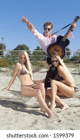 Elvis impersonator with bikini girls.