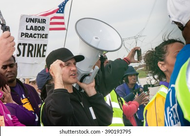 ELWOOD, ILLINOIS - OCTOBER 1, 2012: Striking workers and supporters from the Walmart distribution center march for better wages and working conditions.