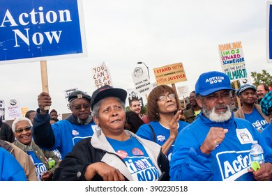 ELWOOD, ILLINOIS - OCTOBER 1, 2012: Striking workers and supporting activist groups march for better wages and working conditions at the Walmart distribution center.