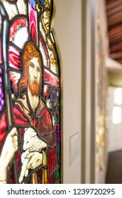 Ely, Cambridgeshire, UK - Circa November 2018: Shallow focus image of an ancient stained glass window, depicting Jesus Christ. Part of an exhibition within the walls of the cathedral.