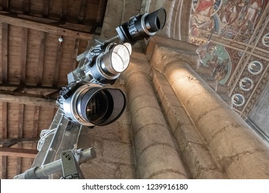 Ely, Cambridgeshire, UK - Circa November 2018: Detailed view of a trio of spotlights seen erected near the top of a famous cathedral interior. Used for projecting light to the congregation below.