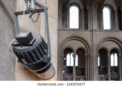 Ely, Cambridgeshire, UK - Circa November 2018: Detailed view of a commercial spotlight on its frame, located in an English cathedral. Used to illuminate the alter and congregation below.