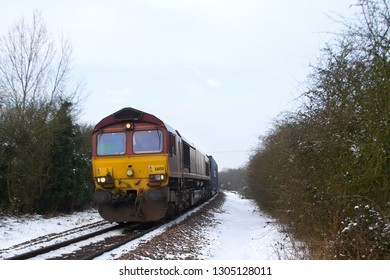 ELY, CAMBRIDGESHIRE, UK - JANUARY 22, 2013: It appears that EWS-liveried Class 66 No. 66150 may have had a 'sheep strike' at some point, judging by the emblem painted on the front face of the loco.