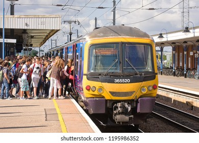 ELY, CAMBRIDGESHIRE, UK - JUL 21, 2012: Platform 2 was awash with Italian youngsters as First Capital Connect Class 365 No. 365520 pulled into Ely Station, embarking the 08:56 King's Lynn to London.