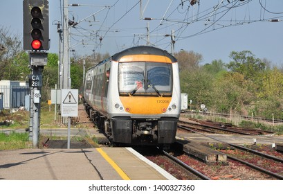 ELY, CAMBRIDGESHIRE/UK - April 20, 2019. Greater Anglia Class 170 DMU leaves platform 1 at Ely station with a northbound train, Cambridgeshire, England