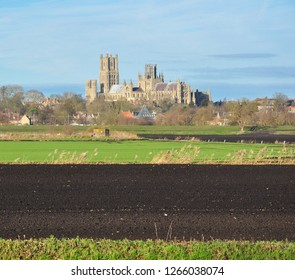 ELY CAMBRIDGESHIRE/UK - December 22, 2018. Ely Cathedral (with Maltings in front and black fen soil in foreground), Ely, Cambridgeshire, England