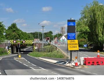 ELY, CAMBRIDGESHIRE/UK - May 23, 2019. Notorious very low bridge under railway line and former level crossing, Ely, Cambridgeshire, England