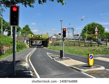 ELY, CAMBRIDGESHIRE/UK - May 23, 2019. Notorious very low bridge under railway line, Ely, Cambridgeshire, England