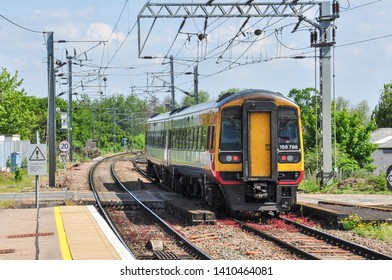 ELY, CAMBRIDGESHIRE/UK - May 23, 2019. East Midlands class 158 'Express Sprinter' DMU returns north from Ely, Cambridgeshire, England