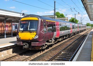 ELY, CAMBRIDGESHIRE/UK - May 23, 2019. Cross Country Class 170 'Turbostar' DMU with a northbound train waits at platform 1, Ely, Cambridgeshire, England