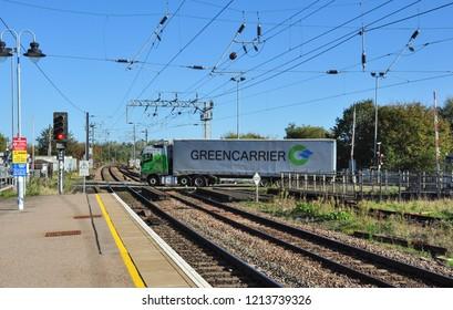 ELY, CAMBRIDGESHIRE/UK - October 22, 2018. Vehicles traverse the level crossing at Ely railway station, Cambridgeshire, England