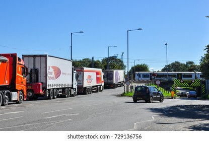 ELY, CAMBRIDGESHIRE/UK - September 22, 2017. Lorries queued up at the railway level crossing, Ely, Cambridgeshire, England