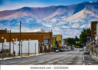 Ely, NV / USA - 08-17-2013: Route 50, the main street in western town of Ely, Nevada is seen against backdrop of mountain range.