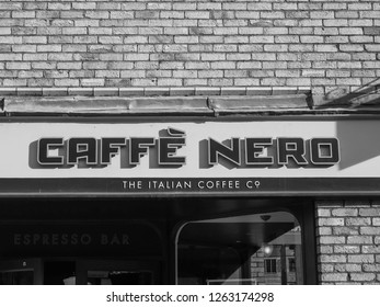 ELY, UK - CIRCA OCTOBER 2018: Caffe Nero (the Italian Coffee company) storefront in black and white
