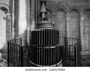 ELY, UK - CIRCA OCTOBER 2018: Ancient circular radiator at Ely Cathedral in black and white