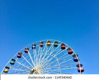 """Elysburg, Pennsylvania, USA - August 4, 2018: View of the colorful """"Giant Wheel"""" at Knoebel's Amusement Park against a clear, blue sky."""