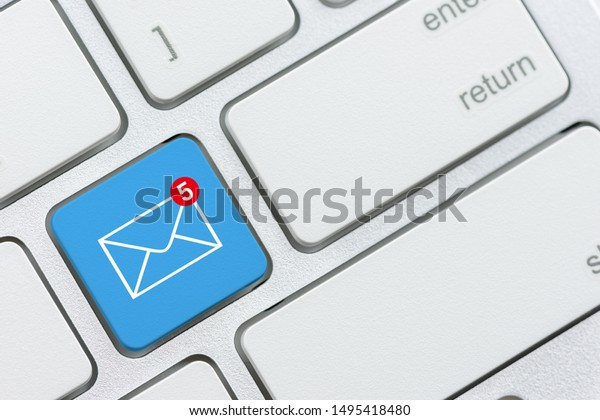 Email alert and message sending concept : Number 5 and envelope on blue computer keyboard button, depicts alert for unread / un-opened message, text messages in an inbox waiting for recipient to read