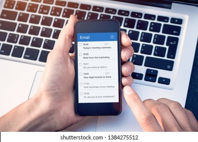 Email app on smartphone screen with business person reading messages from inbox with wireless internet access on mobile phone, communication technology