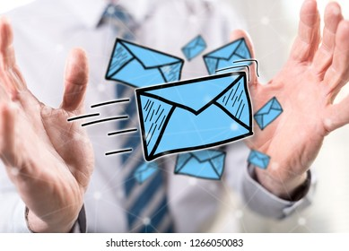 E-mail concept between hands of a man in background