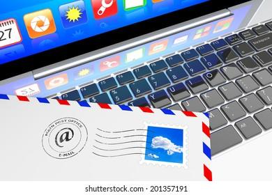 E-mail concept. Envelope letter inbox lying on laptop keyboard