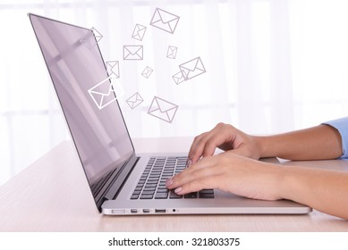 Email concept with laptop and hands