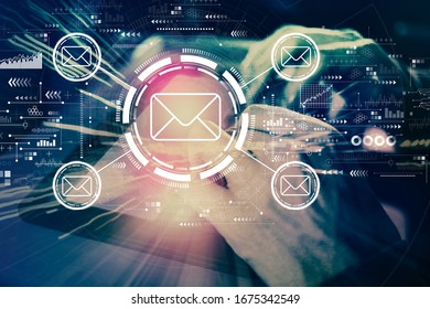 Email concept with man using his tablet computer