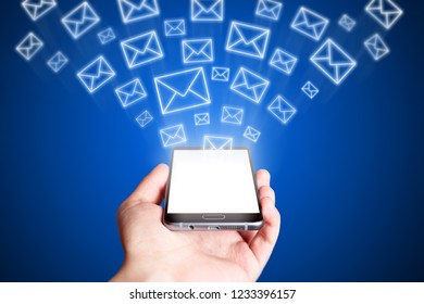 E-mail concept. Mobile phone on blue background